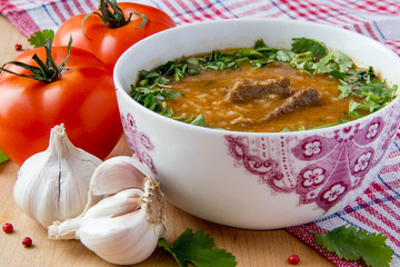 Oriental tomato soup with meat, rice and cilantro