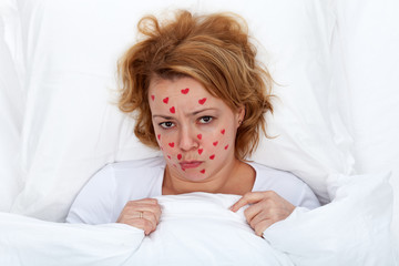 Lovesick woman laying in bed