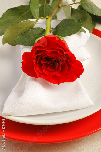Romantic dinner setting with a rose
