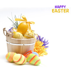 Easter eggs and flowers on the white background.
