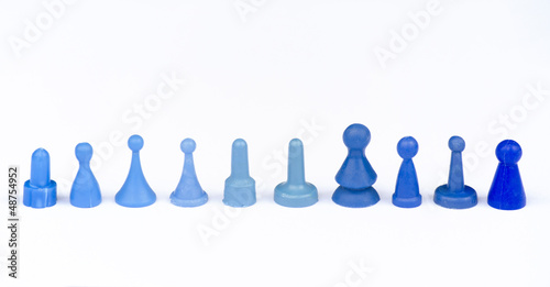 BLUE MONOPOLY FIGURES ON WHITE BACKGROUND