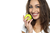 Health conscious woman about to eat fresh green apple poster
