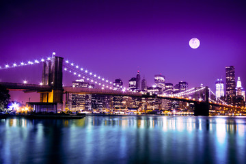 Brooklyn Bridge and NYC skyline with full moon