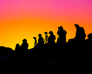 landscape photographers under colorful sky