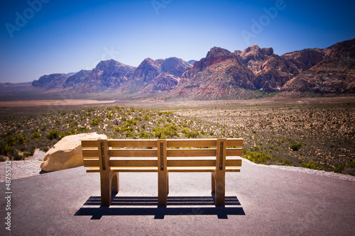 Bench and scenic view of mountain landscape