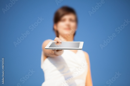 Young woman looking at modern tablet