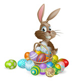 Fototapety Easter bunny rabbit with Easter eggs basket