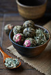 Green tea balls and lemon grass in a ceramic dish