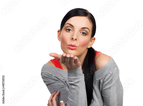 Young woman sending kiss - isolated