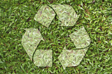 recycle symbol on grass texture
