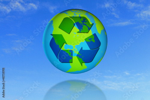 recycle symbol on earth with blue sky background