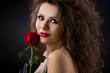glamorous young woman with rose