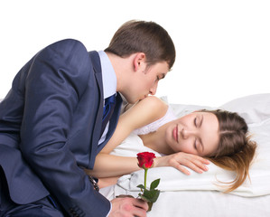 man, woman and red rose