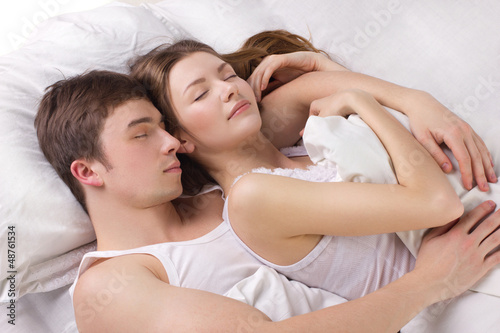 Young man and woman in a bed