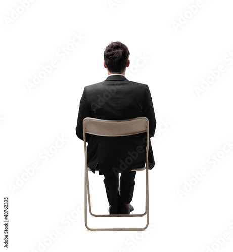 businessman sitting back