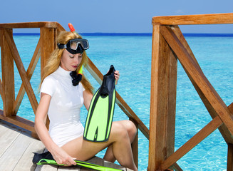 Young pretty woman with flippers, mask and tube. .Maldives...