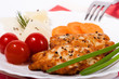 Chopped chicken meat cutlet with salty tomatoes