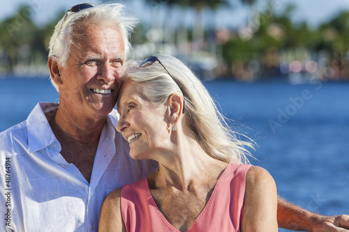 Happy Senior Couple Walking Tropical Sea or River