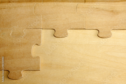 Puzzle on wooden boards abstract background concept
