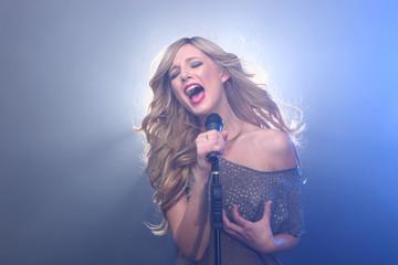 Beautiful Blonde Rock Star on Stage Singing