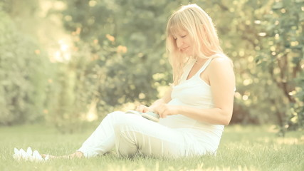 Pregnant woman playing with bootee. Slow motion, retro toned