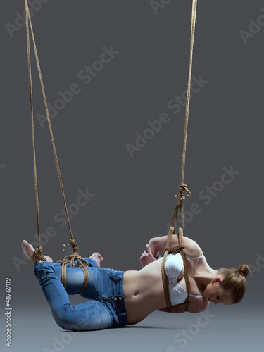 Young woman with shibari in studio