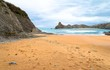 Lonely beach in Cantabria with cliffs in the background