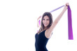 Young woman with pilates strap in hand on white background