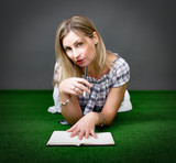 woman writing a book poster
