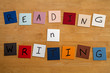 'READING n WRITING' on word tiles - Education, Schools, Teach.