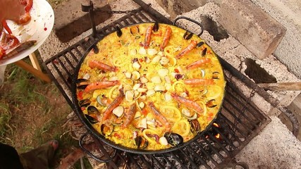 Seafood paella in the fry pan, typical Spanish dish (paella de m