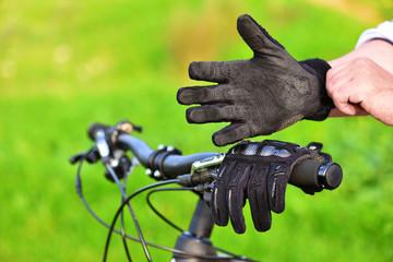 Mountain biker wears old gloves