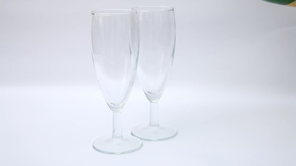Sparkling wine poured into two wineglasses