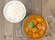 Paneer Butter Masala - Indian curd cheese curry and rice.