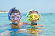 The girl with her father in scuba mask