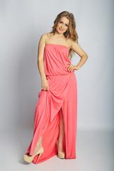 beautiful girl in rose long year peasant woman's dress