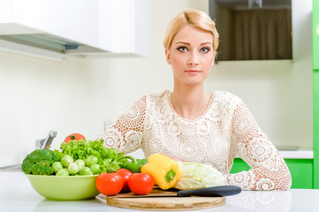 Young woman in the kitchen.Healthy Food. Dieting Concept.
