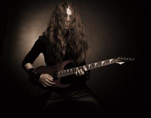 Furious metal guitarist
