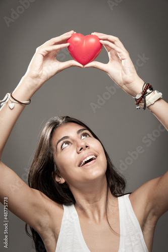 holding a red heart
