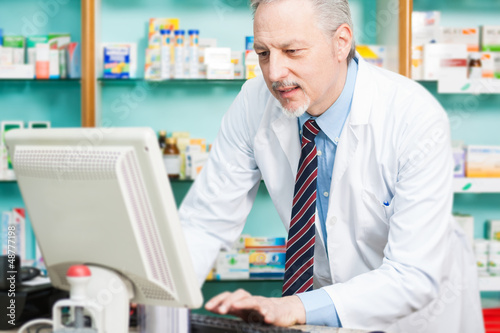 Man at work in a pharmacy