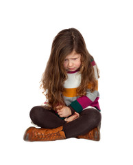 Sad little girl with long hair sitting
