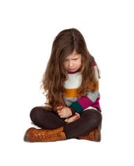 Sad little girl with long hair sitting