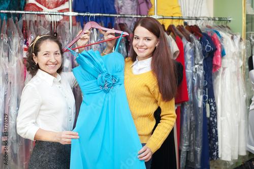 women chooses blue evening gown