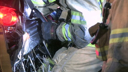 Firefighter Uses Jaws of Life to Extricate Trapped Victim