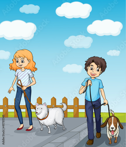 A smiling girl and a boy having dog