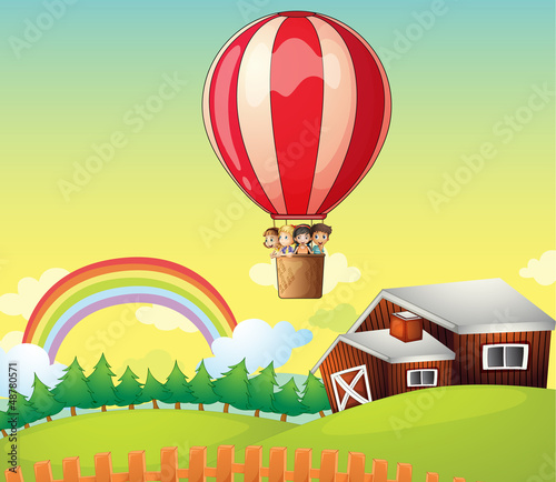 Foto op Canvas Boerderij Kids in an air balloon and a house
