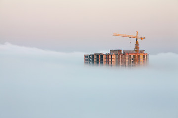 building covered by fog
