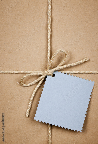 Gift with blue card in brown paper