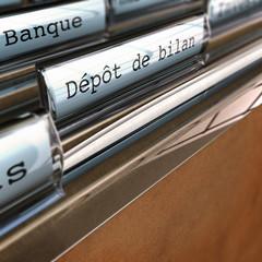 dépôt de bilan, faillite, cessation d'activité.