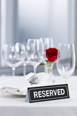Romantic dinner setting with reserved sign